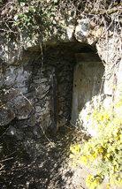 Horizontal mine opening showing the door.