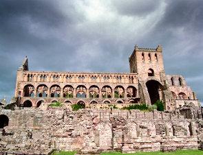 Jedburgh Abbey under a glowering sky