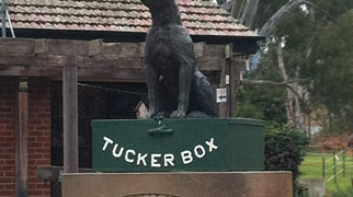 Dog on the Tuckerbox>