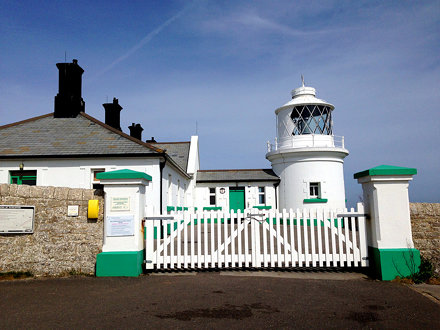 Lighthouse With White Picket Fence