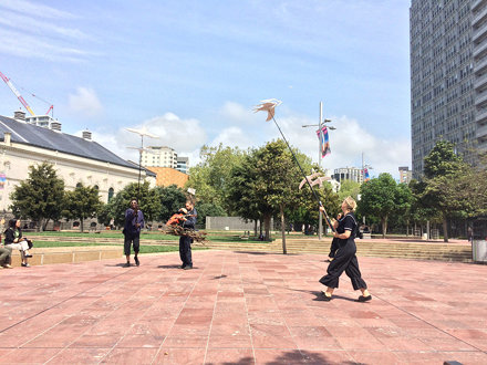 A nest and some birds are doing a show on Aotea Square...