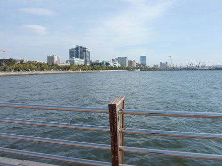 View from a Baku pier towards the docks and oil wells