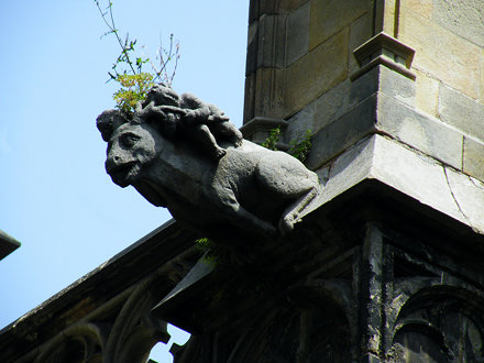 Gargoyle carrying baby and ... a plant