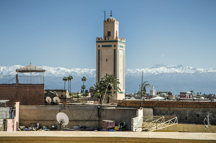 ben youssef mosque and atlas mountains