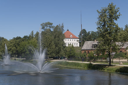 View to Biržai Castle over Agluona River with fountains, 01.07.2019.