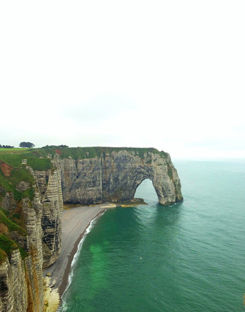 "Étretat is best known for its cliffs, including three natural arches and the pointed ""needle&qu"