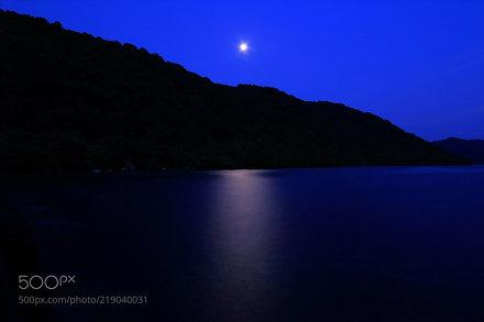 The moon light path on the night lake