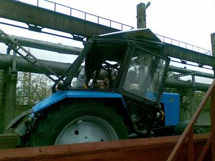 tractor mtz belarus 82.1 after falling from bridge