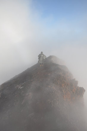 On the crater rim amongst the clouds on the summit of Kerinci