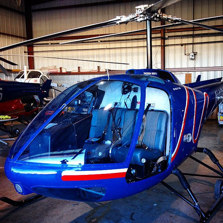 In the hangar checking out the Enstrom helicopter. Erie Airport. #airport #helicopter #chopper #hang