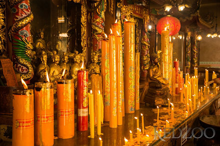 A lot of candles in the temple